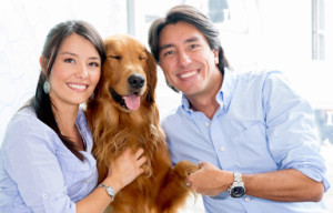 bigstock-Happy-couple-holding-their-dog-44365765OPT
