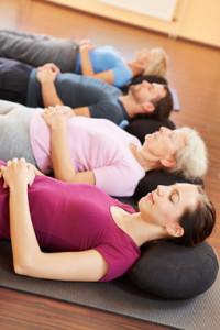 bigstock-Mixed-group-in-yoga-class-rela-39274342OPT