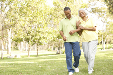 bigstock-Senior-Couple-Walking-In-Park-13909586OPT