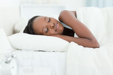 bigstock-Serene-woman-sleeping-against--25385486OPT
